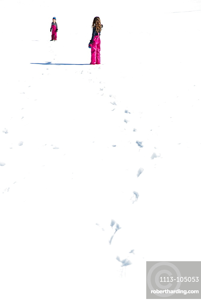 girl and boy trudging through the snow in winter, Pfronten, Allgaeu, Bavaria, Germany