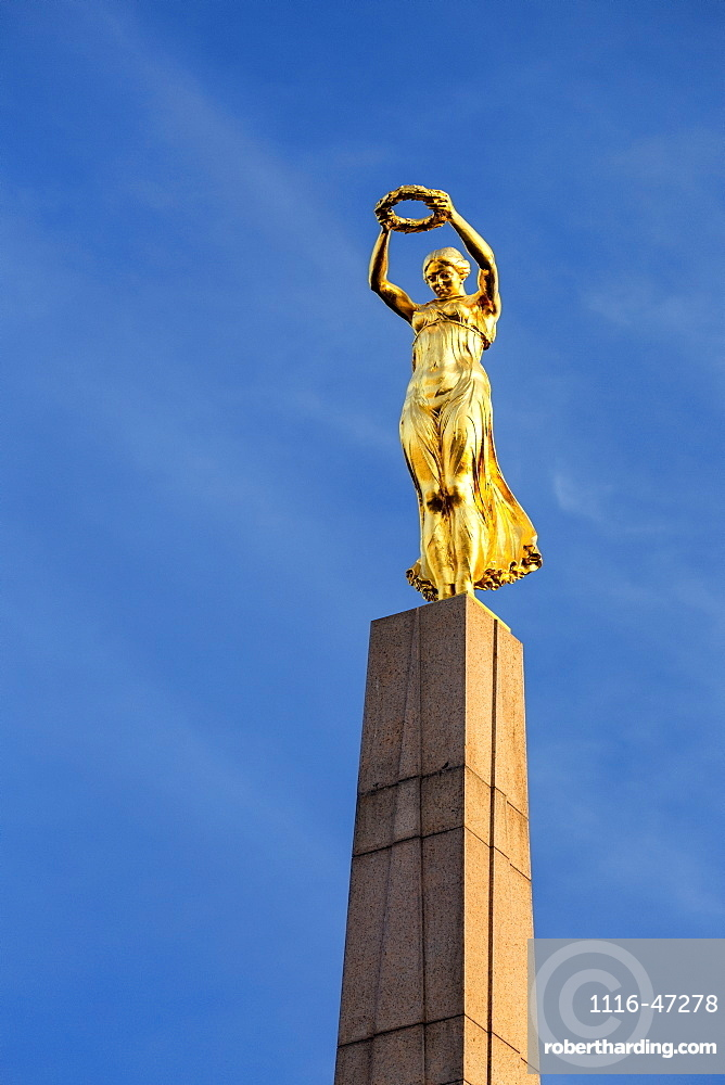 Close-up of gold statue on top of the Monument of Remembrance against blue sky, Luxembourg City, Luxembourg