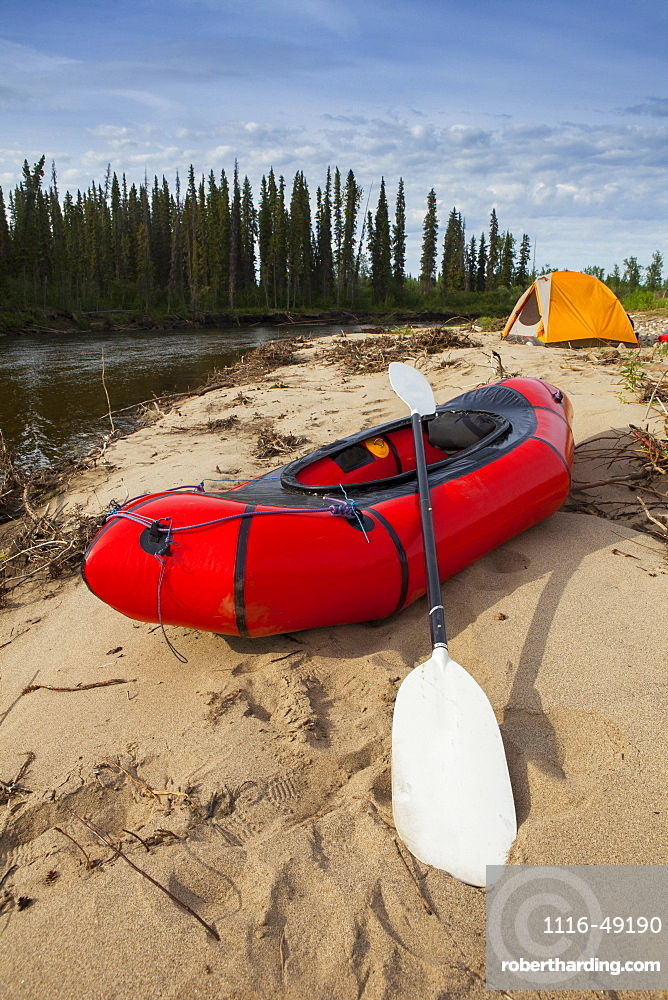 Tent and packraft on sandy beach on the Charley River, Yukon–Charley Rivers National Preserve, Alaska, United States of America
