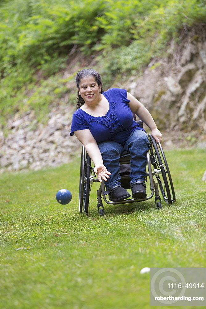 Woman with Spina Bifida in a wheelchair playing bocce ball