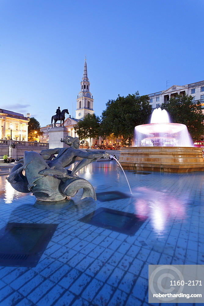 Fountain with statue of George IV and St. Martin-in-the-Fields church, Trafalgar Square, London, England, United Kingdom, Europe