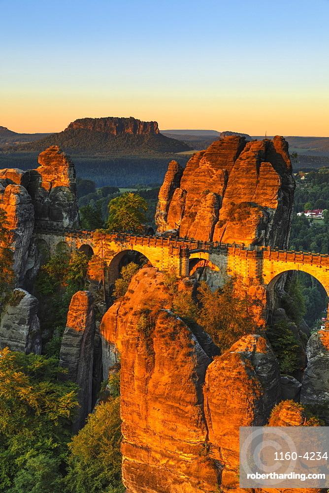 Bastei Bridge at sunrise, Lilienstein Mountain, Elbsandstein Mountains, Saxony, Germany, Europe