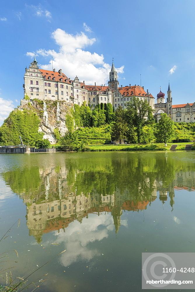 Sigmaringen Castle reflecting in Danube river, Upper Danube Valley, Swabian Jura, Baden-Wuerttemberg, Germany