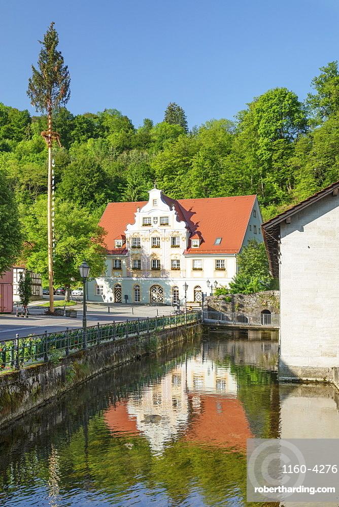 Town hall reflecting in Brenz River, Koenigsbronn, Swabian Jura, Baden-Wuerttemberg, Germany