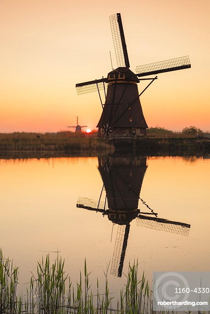 Windmills at sunset, Kinderdijk, UNESCO World Heritage Site, South Holland, Netherlands, Europe