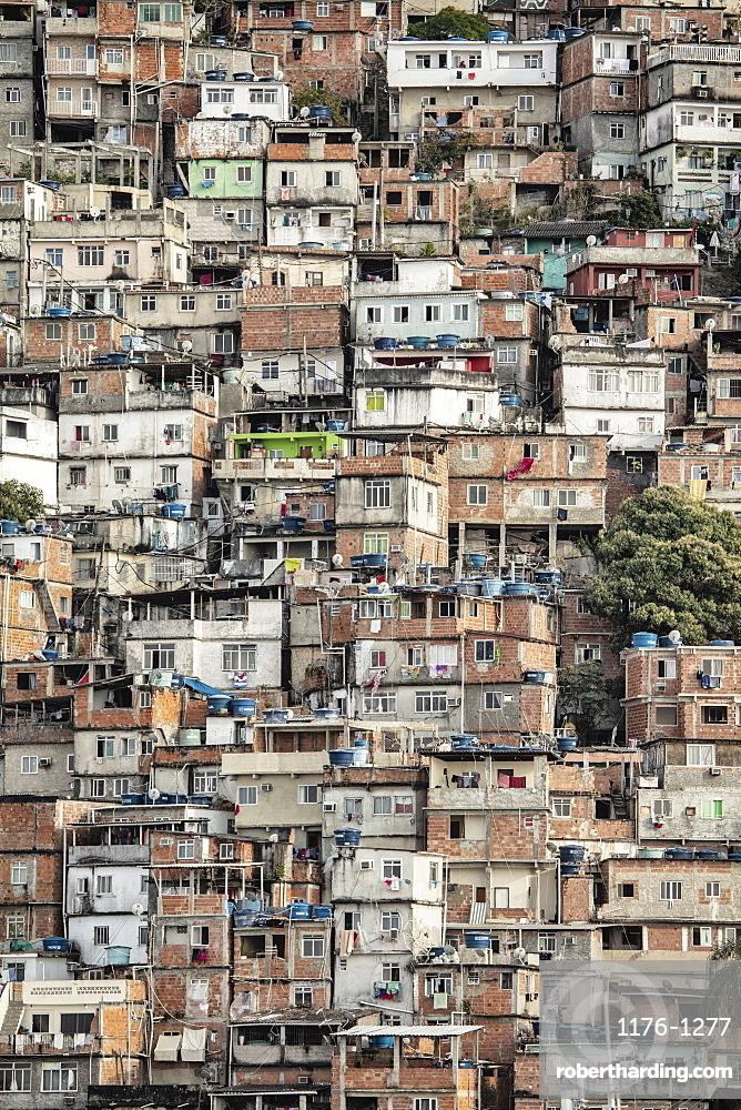 South America, Brazil, Rio de Janeiro. View of poor housing in the favela slum, Cantagalo near Copacabana Beach