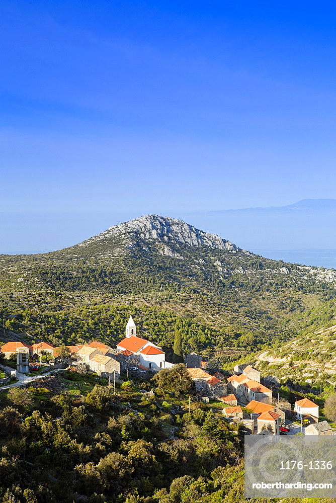 Velo Grablje village and mountains against the Adriatic Sea, Hvar Island, Dalmatia, Croatia, Europe