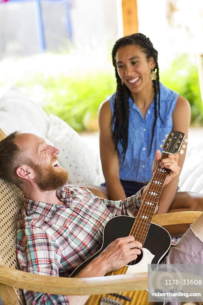 Couple playing music in backyard