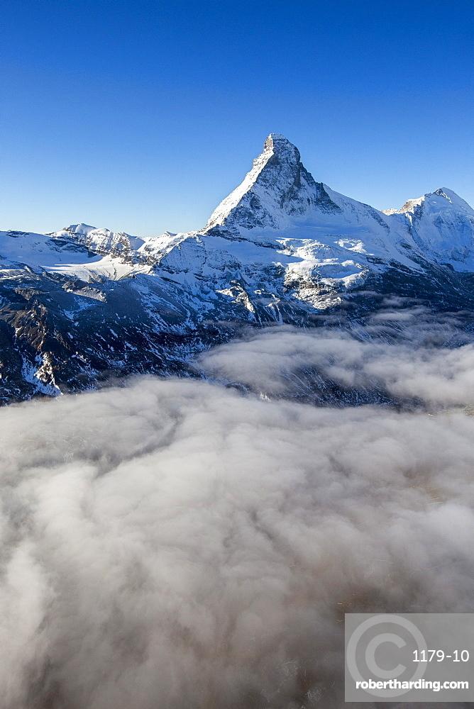 Fog revealing the mountain range surrounding the massif of the Matterhorn, Swiss Canton of Vaais, Swiss Alps, Switzerland, Europe