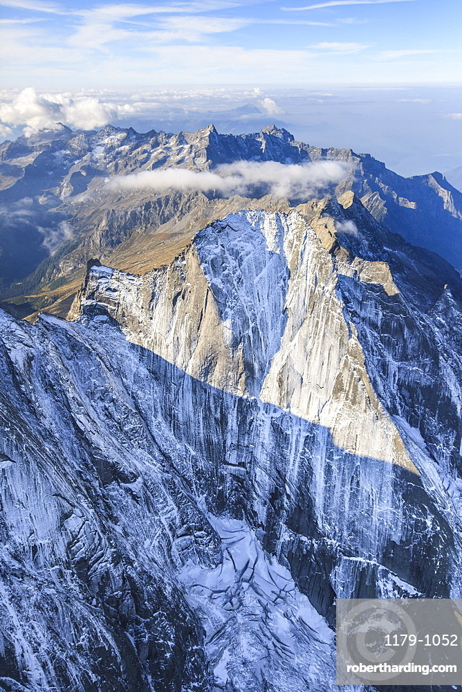 Aerial view of the north face of Piz Badile located between Masino and Bregaglia Valley, border of Italy and Switzerland, Europe
