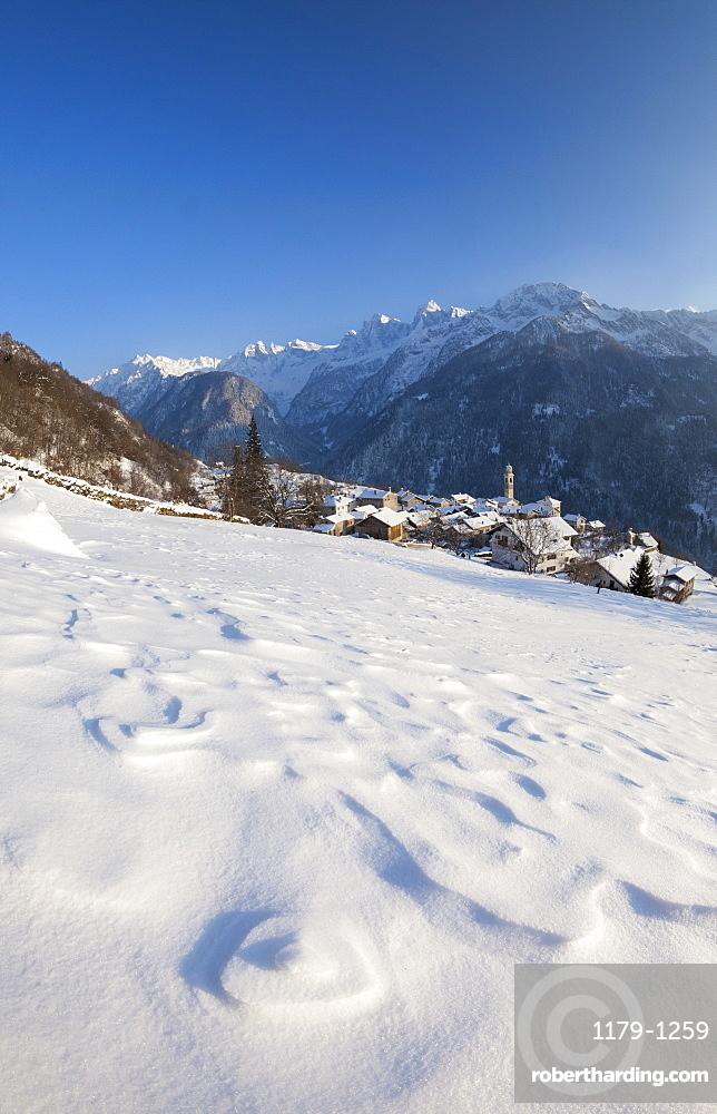 Sunset on the snowy village of Soglio, Maloja District, Bregaglia Valley, Engadine, Canton of Graubunden, Switzerland, Europe