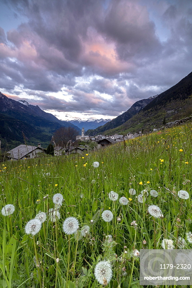 Clouds at dawn on the alpine village of Soglio, Maloja, Bregaglia Valley, Engadine, Canton of Graubunden, Switzerland, Europe