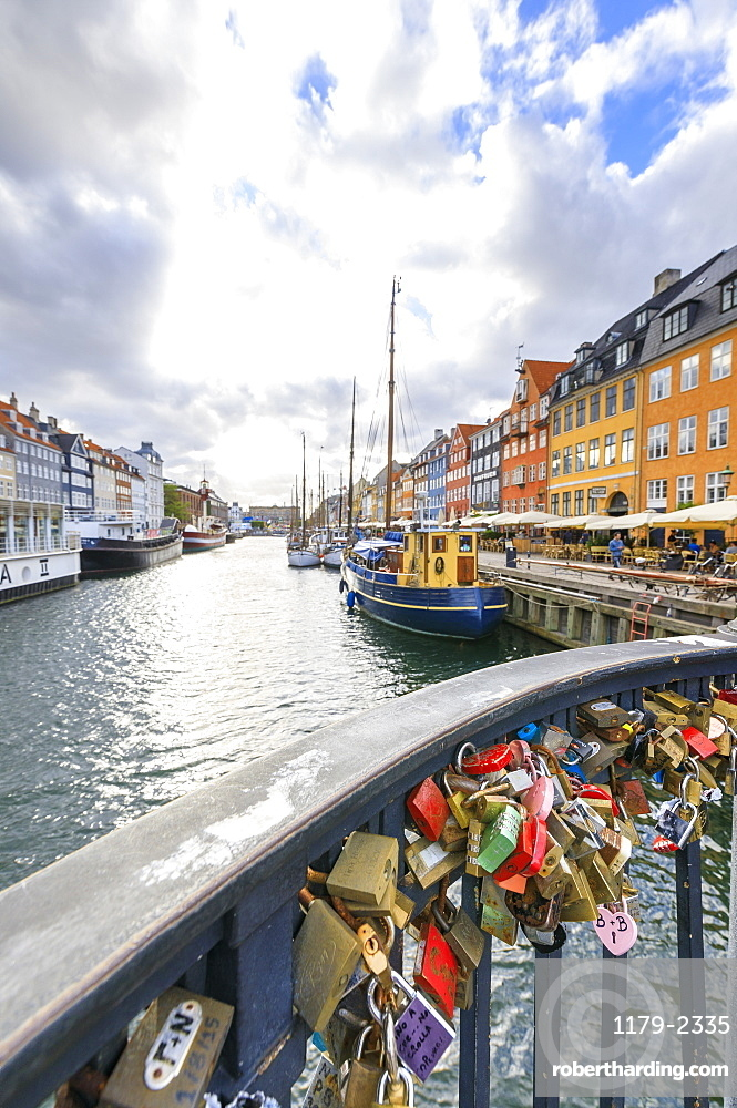 Padlocks on a terrace along the typical canal and harbour of the district of Nyhavn, Copenhagen, Denmark, Europe