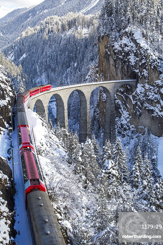 The red train of the Albula-Bernina Express Railway, UNESCO World Heritage on the famous Landwasser Viaduct, Switzerland, Europe