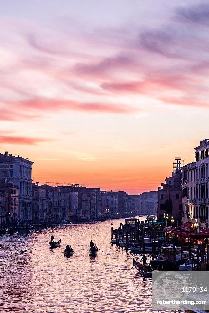 The Grand Canal and gondolas at twilight, Venice, UNESCO World Heritage Site, Veneto, Italy, Europe