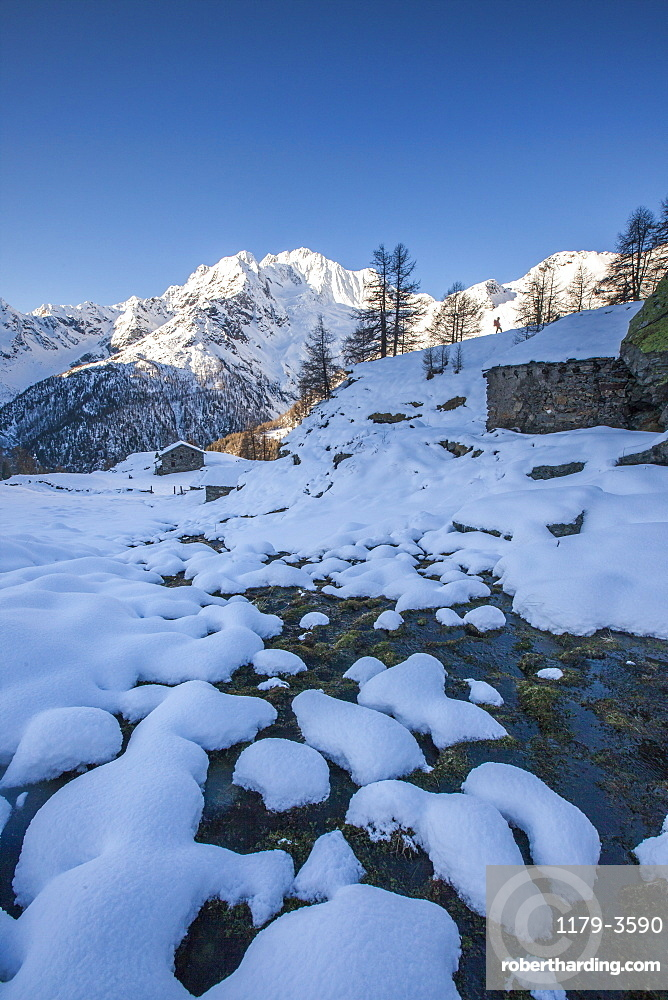 Snow on rocks along the creek with Monte Vazzeda on background, Alpe dell'Oro, Valmalenco, Valtellina, Lombardy, Italy, Europe