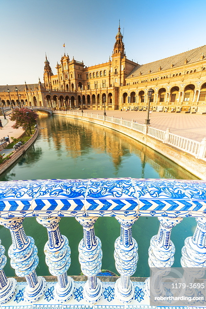 Overview of canal and portico from a decorated glazed ceramic balustrade, Plaza de Espana, Seville, Andalusia, Spain, Europe