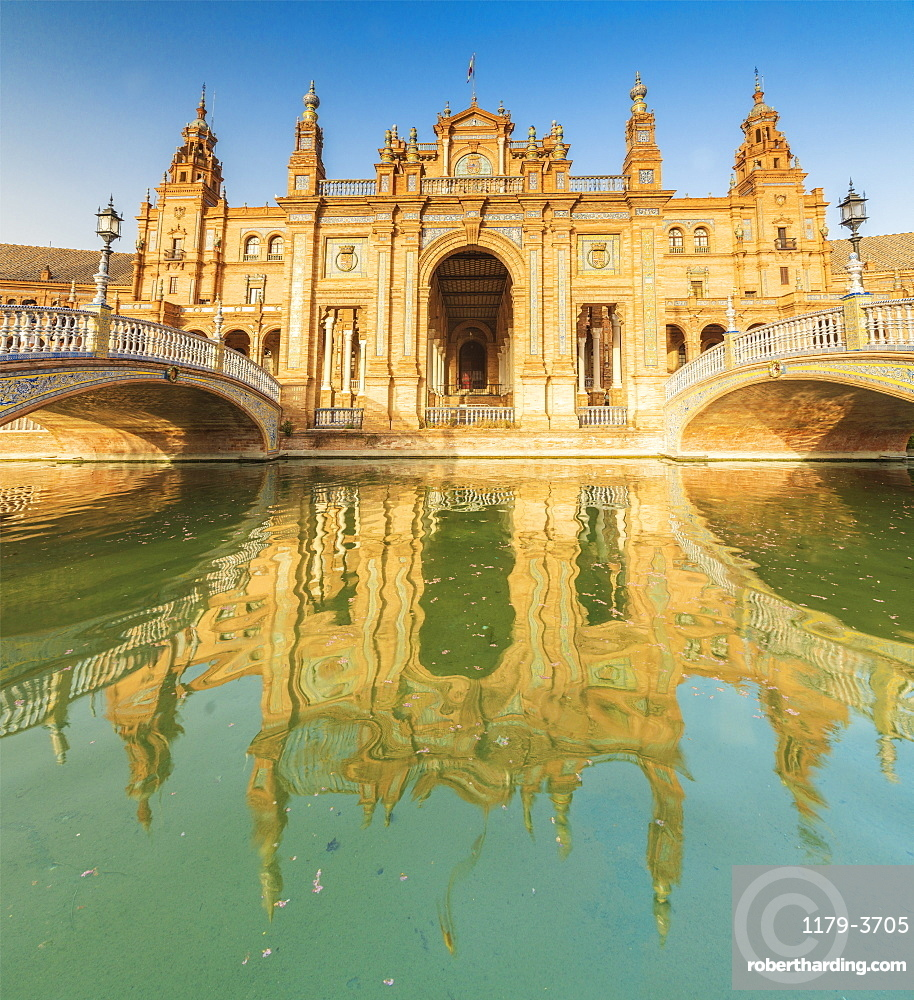 Panoramic of the old palace built in Neo-Mudejar style and Art Deco bridges on canal, Plaza de Espana, Seville, Andalusia, Spain, Europe