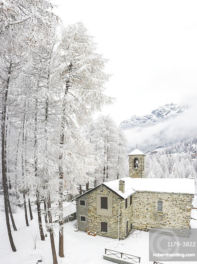 Stone church during winter in San Giuseppe, Valtellina, Italy, Europe