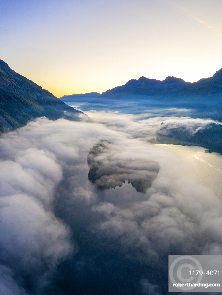 Lake Silvaplana and Sils hidden by the autumnal fog at dawn, aerial view, canton of Graubunden, Engadin, Switzerland (drone)