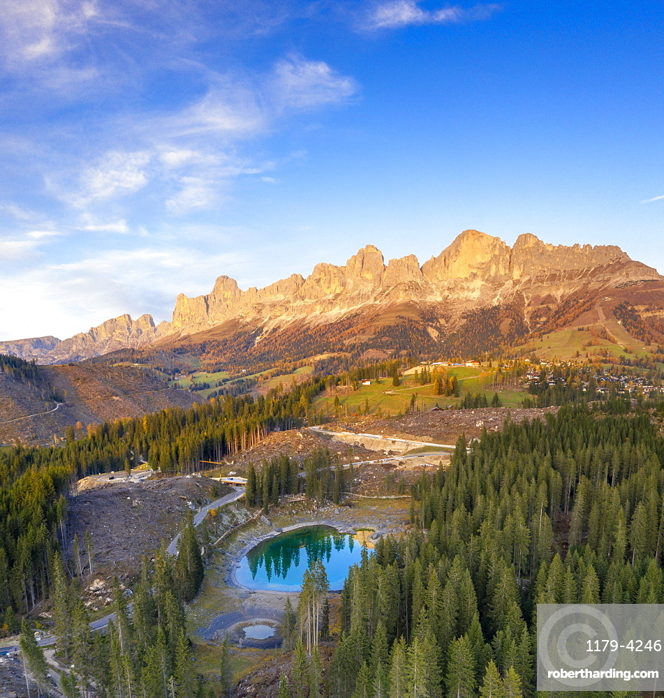 Deforestation surrounding Carezza Lake after the violent Vaia storm, aerial view, Dolomites, South Tyrol, Italy