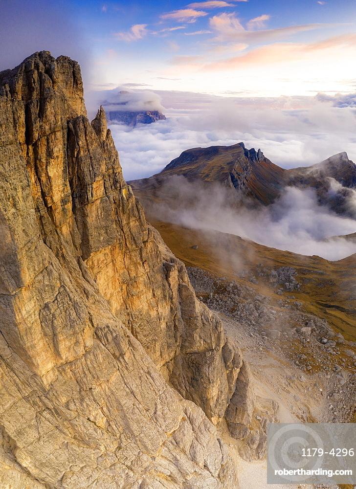 Aerial view by drone of autumn sunset over Lastoi De Formin, Mondeval and Monte Pelmo, Giau Pass, Dolomites, Belluno, Veneto, Italy, Europe
