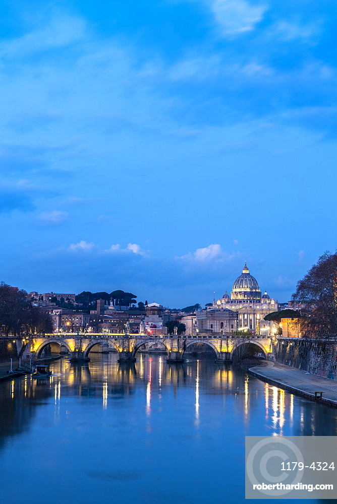 River Tiber with Umberto I Bridge and St. Peter's Basilica (Basilica di San Pietro) in background at dusk, Rome, Lazio, Italy, Europe