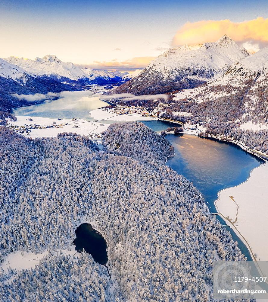 Aerial view of snowy woods around Lej Nair, Piz Polaschin, Piz La Margna, Silvaplana and Lej DaChampfer, Engadine, Switzerland