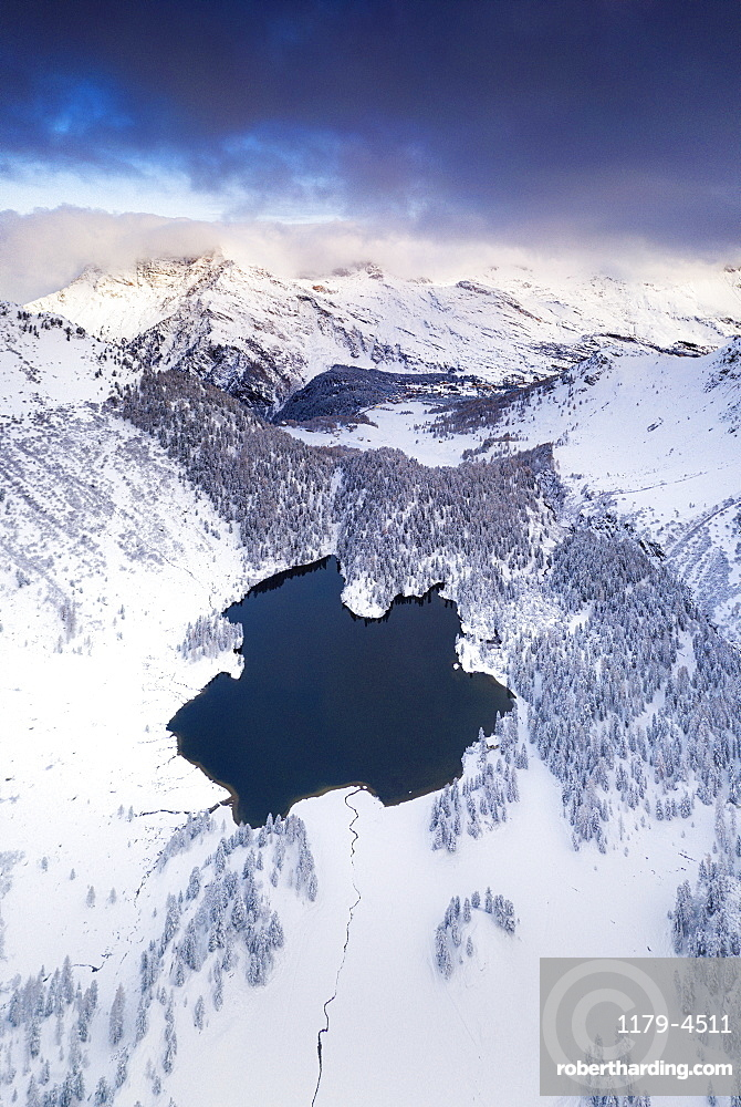 Lake Cavloc surrounded by snow, aerial view, Bregaglia Valley, canton of Graubunden, Engadine, Switzerland