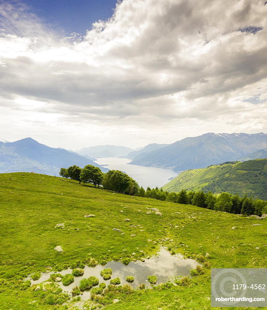 Alto Lario and Lake Como seen from green meadows of Montemezzo mountains, Lombardy, Italian Lakes, Italy, Europe