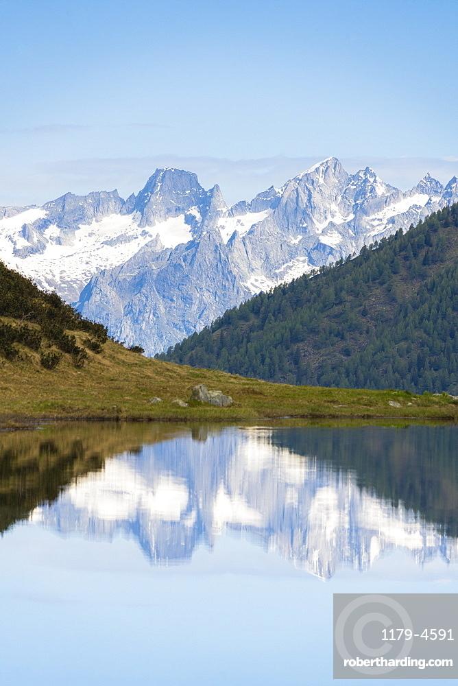 Piz Badile and Cengalo reflected in Porcile Lakes, Val Lunga, Tartano Valley, Valtellina, Sondrio province, Lombardy, Italy