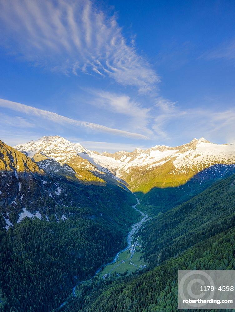 Aerial panoramic of Monte Disgrazia and Chiareggio valley at dawn, Valmalenco, Sondrio province, Valtellina, Lombardy, Italy