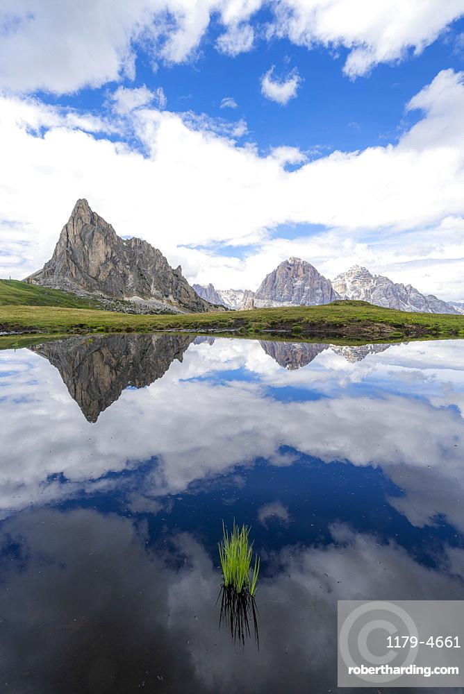 Ra Gusela and Tofane mountains mirrored in water, Giau Pass, Dolomites, Belluno province, Veneto, Italy, Europe
