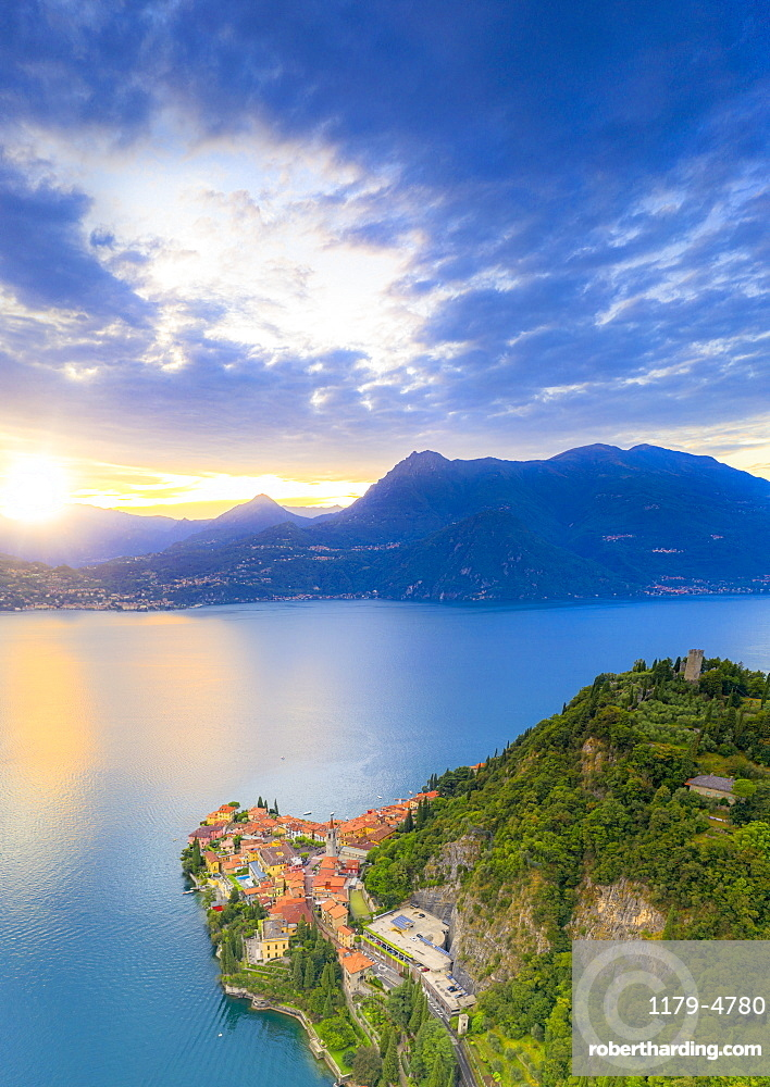 Aerial view of the old Vezio castle on hills above Varenna at sunset, Lake Como, Lecco province, Lombardy, Italy