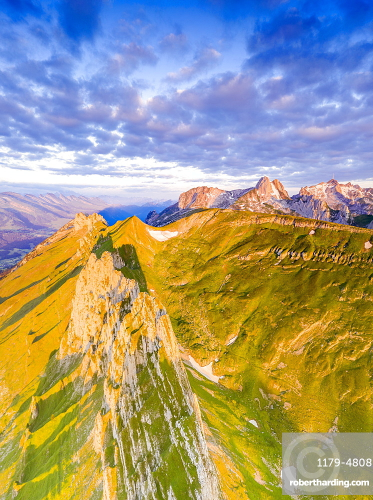 Clouds at dawn over the majestic peaks of Santis and Saxer Lucke, aerial view, Appenzell Canton, Alpstein Range, Switzerland, Europe
