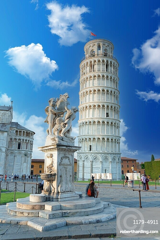 Tourists admiring the Renaissance fountain and the leaning tower of Pisa in summer, Tuscany, Italy