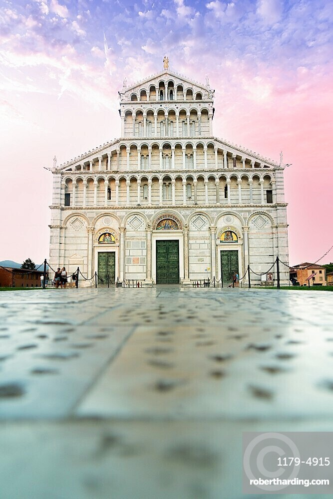 Romanesque facade of Pisa Cathedral (Duomo) under romantic sky at sunrise, Piazza dei Miracoli, Pisa, Tuscany, Italy