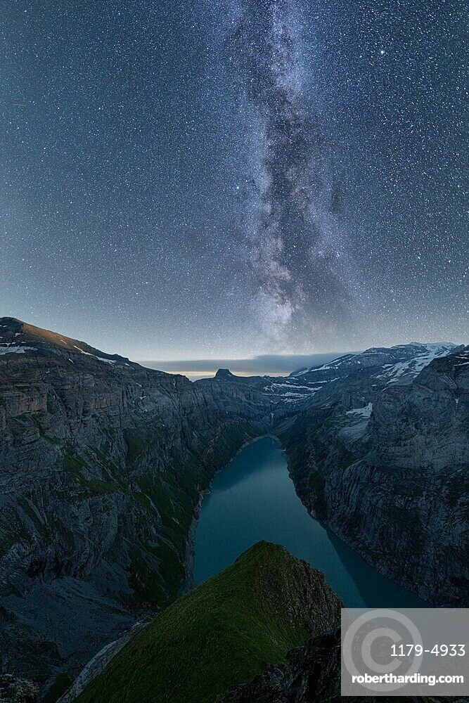 Milky way in the starry night sky over lake Limmernsee, aerial view, Canton of Glarus, Switzerland