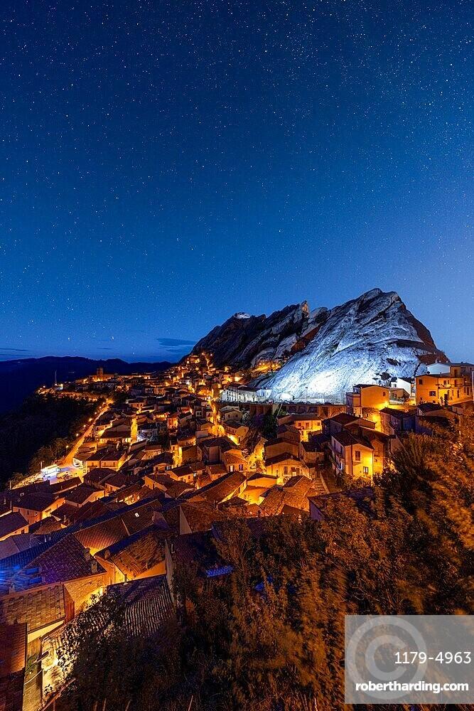 Stars in the night sky over the medieval town of Pietrapertosa, Dolomiti Lucane, Potenza province, Basilicata, Italy