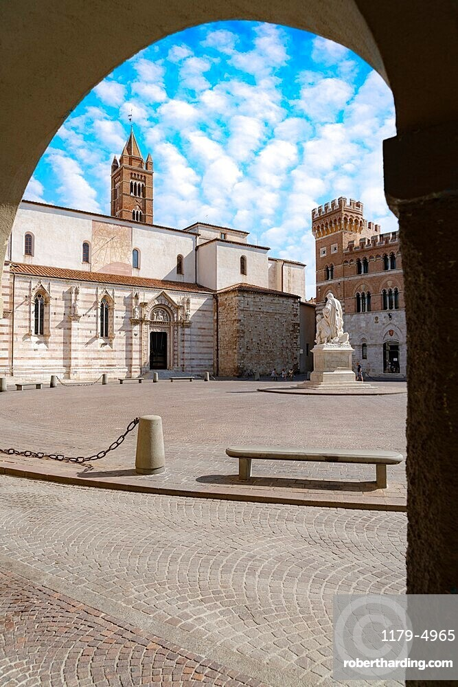 San Lorenzo Cathedral (Duomo) and Canapone monument statue viewed from the old arcade, Grosseto, Tuscany, Italy, Europe