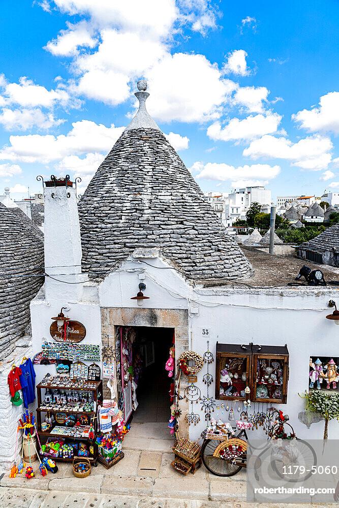 Handcraft souvenirs in the Trullo traditional stone hut, Alberobello, province of Bari, Apulia, Italy