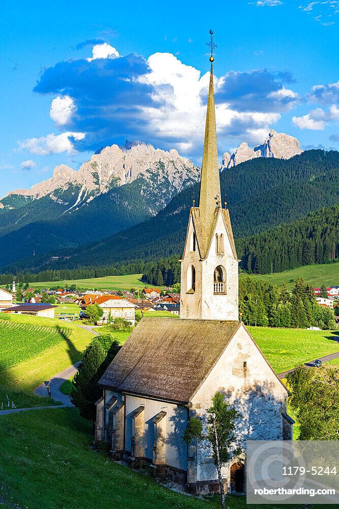 Church in the green landscape of alpine village of Villabassa /Niederdorf, Val Pusteria, Bolzano province, South Tyrol, Italy