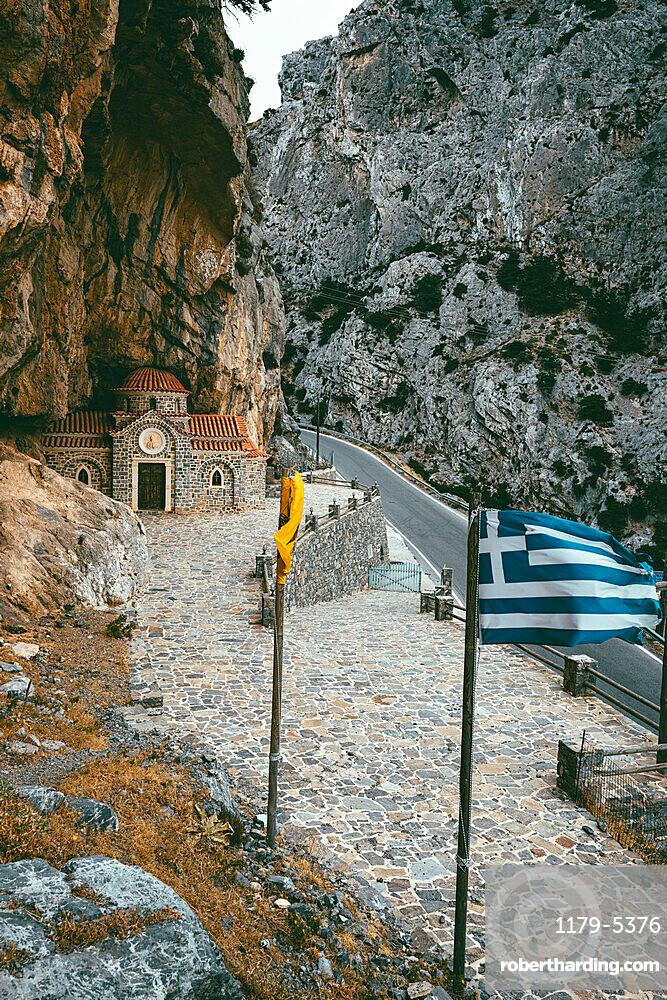 Narrow road crossing Kotsifou gorge nearby the old Agios Nikolaos chapel built in rocks, Crete island, Greece