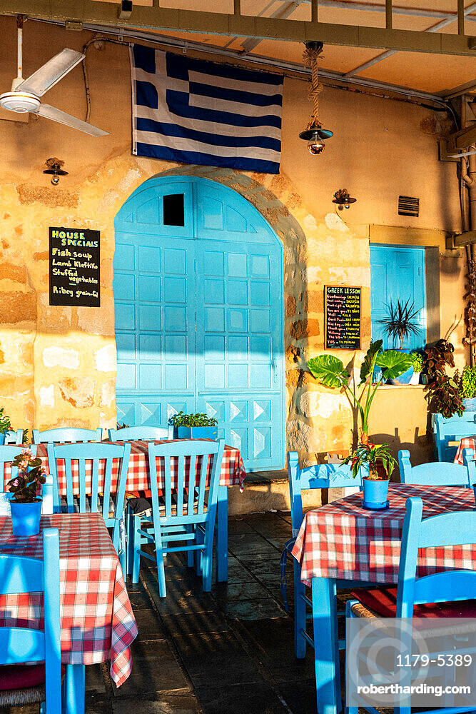 Greek traditional restaurant painted with iconic blue color, Chania, Crete, Greece