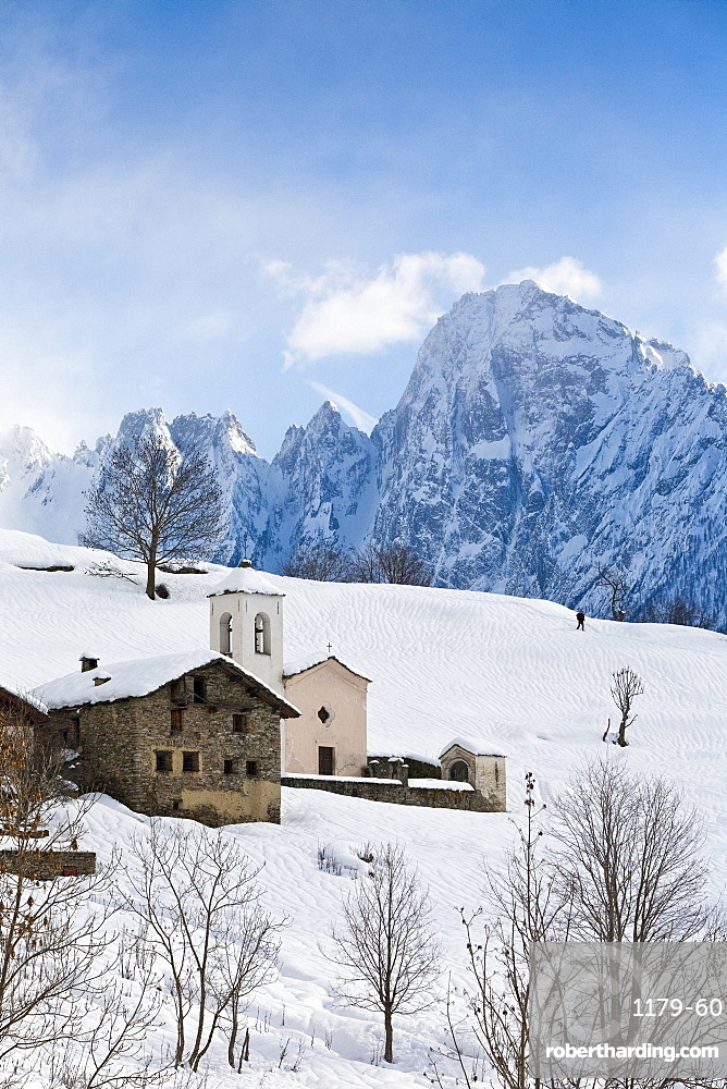 The tiny village of Daloo in Valchiavenna, with its bell tower and church, after a heavy snowfall, Lombardy, Italy, Europe