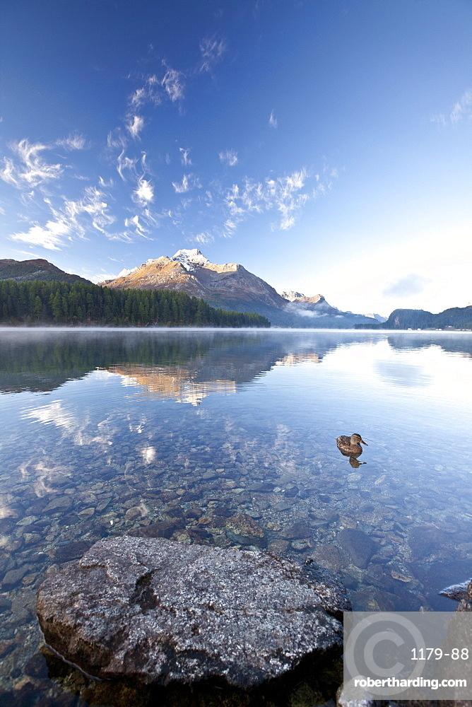 Piz da la Margna reflecting in Lake Sils by Saint Moritz in Engadine, Graubunden, Switzerland, Europe