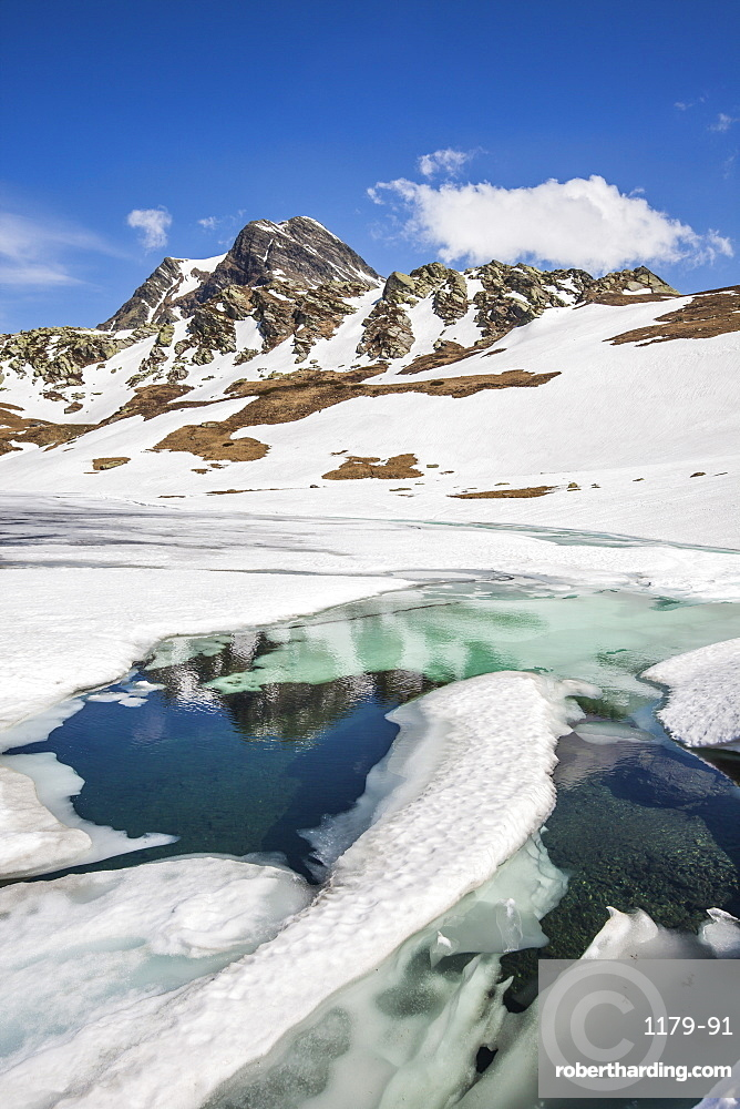 Spring is coming and lake Emet in the Spluga Valley is slowly thawing, Lombardy, Italy, Europe