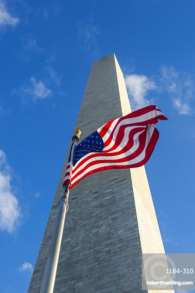 American flag in front of the Obelisk of the Washington Monument at the Mall,  Washington, District of Columbia, United States of America, North America