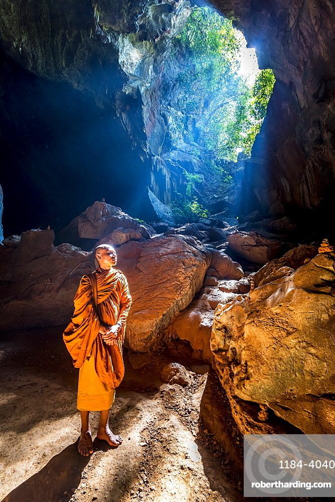 Buddhist Monk standing in Saddan Cave, Hpa-An, Kayin state, Myanmar (Burma), Asia