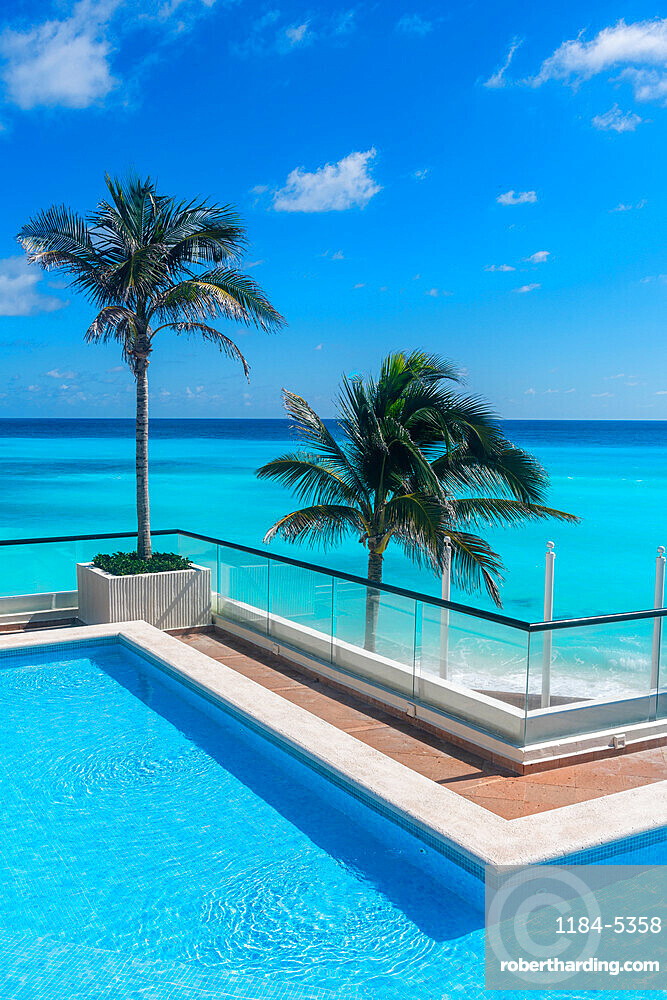 Swimming pool over the turquoise waters of Cancun, Quintana Roo, Mexico, North America